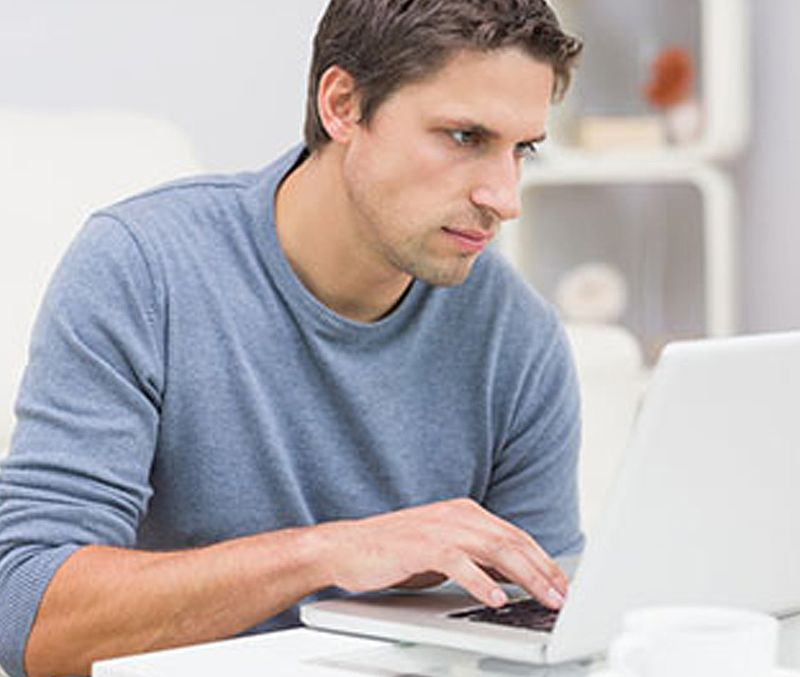 Man surfing web on a laptop
